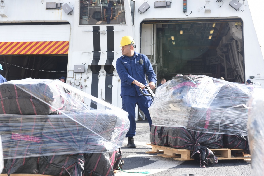US Coast Guard officers offload cocaine