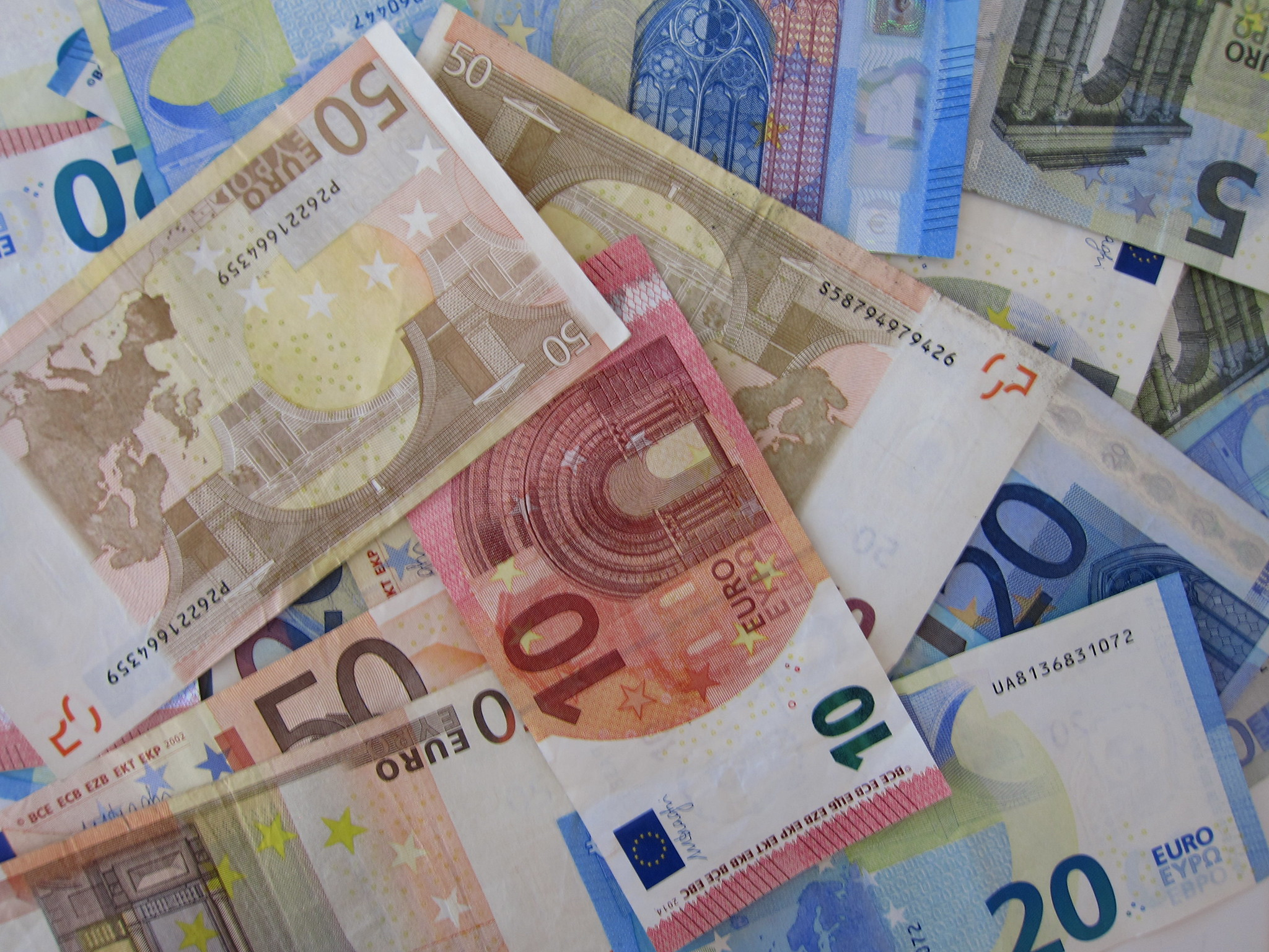 counterfeit currency networks in Madrid and Bogota